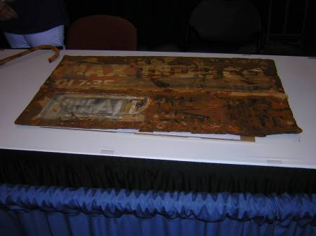 A sign they found in the pit with the buried car. It looks like it faired better...